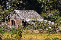 Thatched home in a field, Architecture, Myanmar. Exotic places wall art. Fine art photography prints for sale.