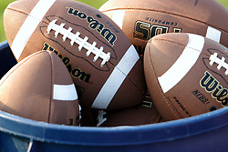 25 AUG 2006  A large plastic trash can of footballs is located on the fields side lines for use in practice.