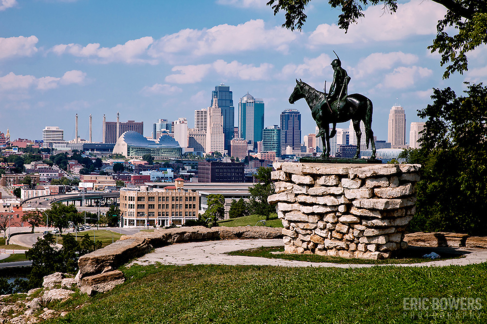 Kansas City's Scout Statue in the daytime at Penn Valley Park overlooking KC's downtown skyline.