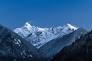 Mount Redoubt and Nodoubt Peak photographed from Chilliwack Lake in Chilliwack Lake Provincial Park in British Columbia, Canada.  Mount Redoubt itself is in North Cascades National Park in Washington State, USA.