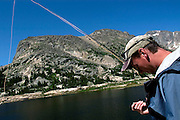 Fly fisherman on a Colorado high mountain lake