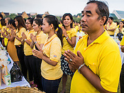 05 DECEMBER 2014 - BANGKOK, THAILAND: Thais line up on Sanam Luang, the parade ground in front of the Grand Palace, for a Buddhist prayer service for Bhumibol Adulyadej, the King of Thailand. Thais marked the 87th birthday of the King Friday. The revered Monarch was scheduled to make a rare public appearance in the Grand Palace but cancelled at the last minute on the instructions of his doctors. He has been hospitalized in Siriraj Hospital, across the Chao Phraya River from the Palace, since early October.    PHOTO BY JACK KURTZ