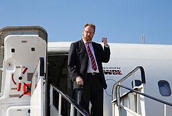CARDIFF, WALES - Sunday, September 7, 2014: Wales' head of international affairs Mark Evans boards the plane at Cardiff Airport as the squad flies to Andorra ahead of the opening UEFA Euro 2016 qualifying match. (Pic by David Rawcliffe/Propaganda)
