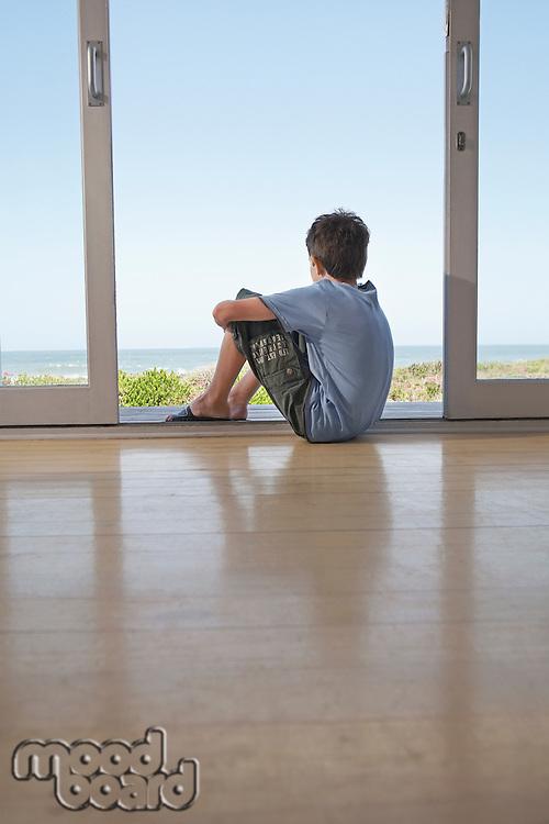 Boy Sitting on Deck
