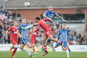 Lewis Alessandra (Hartlepool United) wins a header over Reggie Lambe (Carlisle United) during the EFL Sky Bet League 2 match between Hartlepool United and Carlisle United at Victoria Park, Hartlepool, England on 14 April 2017. Photo by Mark P Doherty.