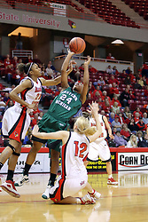 06 December 2008: Tavelyn James meets the resistance of Kenyatta Shelton and Ashley Sandstead while heading for the basket during a game between the Eastern Michigan Eagles and the Illinois State Redbirds on Doug Collins Court inside Redbird Arena on the campus of Illinois State University, Normal Il.