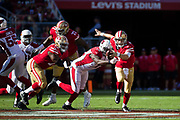 San Francisco 49ers quarterback C.J. Beathard (3) scrambles while being sacked by the Arizona Cardinals at Levi's Stadium in Santa Clara, Calif., on November 5, 2017. (Stan Olszewski/Special to S.F. Examiner)
