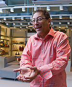 Stuart Weitzman displays his famous crystal shoe designed each year by Hollywood's most notable and then auctioned for charity benefit. Photographed for an editorial assignment by Jeffrey Holmes, a great portrait photographer in New York.