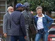 Oxford, MS 11/11/19   James Meredith, the first African American to attend Ole Miss, is on campus shooting a documentary. Pictured with James is his wife Judy Alsobrooks Meredith and Sol B River the director. Meredith is seen standing and sitting by the statue of himself on the campus of the University of Mississippi right behind the Lyceum building. Meredith has never been a fan of the statute and even asked it be removed and destroyed when it was first installed.  Photo copyright ©SuziAltman