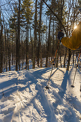 A man snowshoeing on Kennard Hill in Epping, New Hampshire.