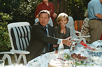25 AUG 1999, BERLIN/GERMANY:<br /> Gerhard Schröder, SPD, Bundeskanzler, und Ehefrau Doris Schröder, gemeinsam im Garten der Mompers bei Kartoffelsalat und Buletten, Kaffee und Kuchen<br /> IMAGE: 19990825-01/03-05<br /> KEYWORDS: Gerhard Schroeder