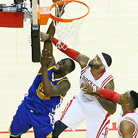 23 May 2015: Golden State Warriors forward Draymond Green (23) goes for the layup past Houston Rockets forward Josh Smith (5) and Houston Rockets center Dwight Howard (12) during the Golden State Warriors 115-80 victory over the Houston Rockets, in game 3 of the Western Conference finals, at the Toyota Center, Houston, Texas, USA.
