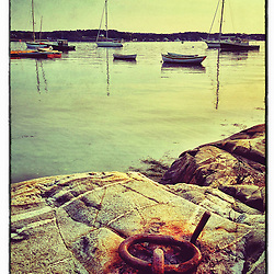 "An iron ring embedded in the bedrock next to a harbor in New Castle, New Hampshire. iPhone photo - suitable for print reproduction up to 8"" x 12""."