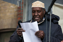 Southall, UK. 27th April 2019. Ahmed Haji Mohamed of Somali Community Leaders Group addresses members of the local community and supporters at a rally outside Southall Town Hall to honour the memories of Gurdip Singh Chaggar and Blair Peach on the 40th anniversary of their deaths. Gurdip Singh Chaggar, a young Asian boy, was the victim of a racially motivated attack whilst Blair Peach, a teacher, was killed by the Metropolitan Police's Special Patrol Group during a peaceful march against a National Front demonstration.