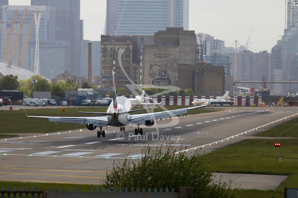 """London City Airport, May 5th 2015. With crosswinds gusting at up to 45 mph, several planes attempting to land at London City Airport have to abort their landings and do a """"go-round"""" whilst others endured rough landings.  PICTURED: Wings rocking, a plane crabs sideways into the runway."""