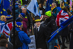 A Jacob Rees-Mogg lookalike mingles with anti-Brexit protesters in Old Palace Yard outside the House of Commons in London where MPs are debating Prime Minister Theresa May's Brexit deal, with a vote to be held in the evening.. London, January 15 2019.