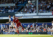Charlie Austin's looping header doesn't end up troubling Simon Moore too much during the Sky Bet Championship match between Queens Park Rangers and Cardiff City at the Loftus Road Stadium, London, England on 15 August 2015. Photo by Andy Walter.