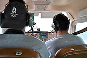 20090921  -  Atlanta, Ga : Pilot David Ortiz (right) and European Press Agency photographer Erik Lesser use a general aviation Cessna 172 single engine airplane to document flood waters in Atlanta on Tuesday, September 22, 2009, caused by several days of rain.    David Tulis         dtulis@gmail.com    ©David Tulis 2009