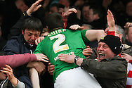 Picture by David Horn/Focus Images Ltd +44 7545 970036.27/04/2013.Paul Quinn of Doncaster Rovers clebrates his team's winning goal with fans during the npower League 1 match at Griffin Park, London.