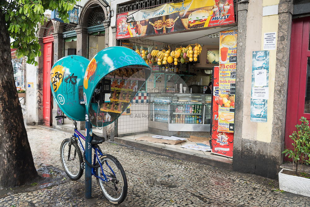 A fruit shop and telephone booth in the Lapa neighborhood of Rio de Janeiro, Brazil.