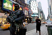 A member of the NYPD Hercules counter terrorism team stands guard on Times Square after the national threat level was raised to orange. The change in threat level came after credible threats that al Qaeda was planning attacks on american targets.
