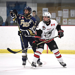 GEORGETOWN, ON  - APR 8,  2018: Ontario Junior Hockey League, South West Conference Championship Series. Game six of the best of seven series between Toronto Patriots and the Georgetown Raiders. Andrew Petrucci #21 of the Toronto Patriots battles for position with Zac Elson #4 of the Georgetown Raiders during the third period.<br /> (Photo by Andy Corneau / OJHL Images)