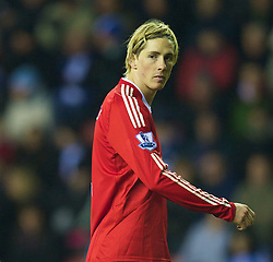 WIGAN, ENGLAND - Monday, March 8, 2010: Liverpool's Fernando Torres looks dejected as his side lose to lowly Wigan Athletic, an truly embarrassing result, during the Premiership match at the DW Stadium. (Photo by David Rawcliffe/Propaganda)