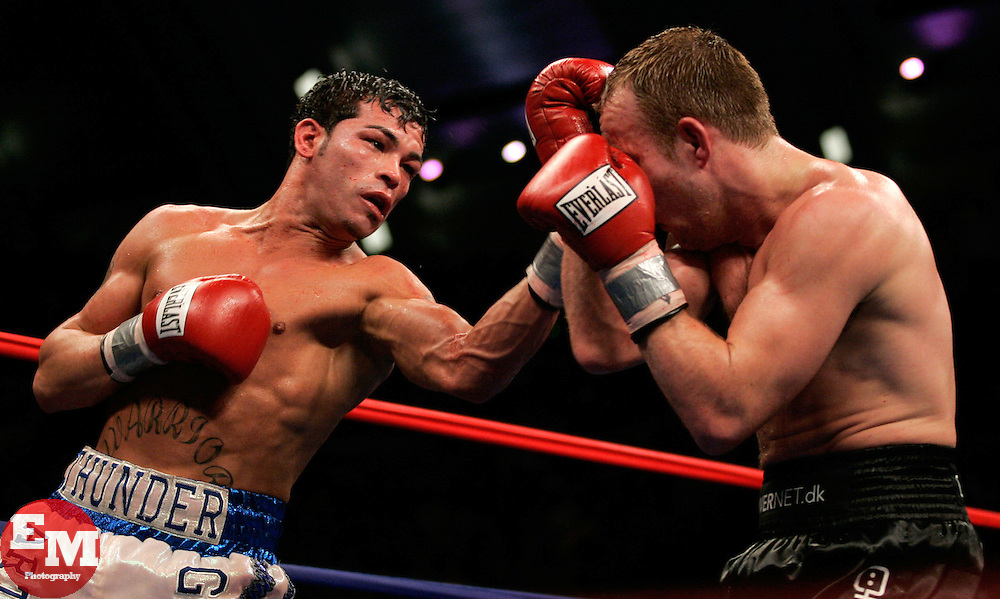 Arturo Gatti (l) and Thomas Damgaard (r) trade punches during their 12 round fight for the IBA Welterweight Championship at Boardwalk Hall in Atlantic City, NJ.  Gatti won the bout via 11th round knockout.