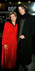 TV presenter PENNY SMITH and MR PAUL WHELAN, at a film premier in London on 11th January 2000.OAB 21