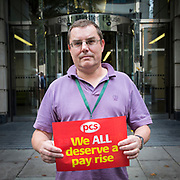 Colin Dunn, Department for Transport (DFT), Great Minster House, Horseferry Road. <br /> PCS members working in the civil service are holding a short, high profile protest to demonstrate about the continued 1% pay cap public sector pay cap that has been in place for 7 years.Westminster,  London,  United Kingdom. (Photo by Andy Aitchison / PCS)
