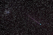 Comet Lovejoy C/2014 Q2 passes about 50 million miles from Earth in this view of the night sky from North Bend, Washington. The comet's green coma results from molecules of diatomic carbon flourescing in ultraviolet sunlight. The tail is faint because this comet is producing very little dust. It's a long-period comet; it won't be seen again from Earth for about 8,000 years. Pleiades is the bright star cluster in the upper left corner of the image.