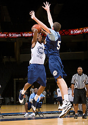 WF Damon Powell (Oakland, CA / McClymonds) shoots a jumper over PF Ryan Kelly (Raleigh, NC / Ravenscroft).  The NBA Player's Association held their annual Top 100 basketball camp at the John Paul Jones Arena on the Grounds of the University of Virginia in Charlottesville, VA on June 20, 2008