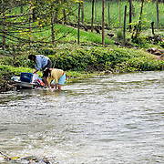 Two women do their laundry early in the morning in the river in Sam Neua (also spelled Samneua, Xamneua and Xam Neua) in northeastern Laos.