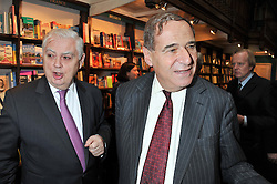 Left to right, LORD LAMONT OF LERWICK and LORD BRITTAN OF SPENNITHORNE at a party to celebrate the publication of Stanley Johnson's new book 'Where The Wild Things Were' held at Daunt Books, 83 Marylebone High Street, <br /> London W1 on 18th July 2012.
