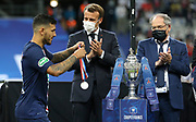 Leandro Paredes of PSG holding his medal, French President Emmanuel Macron, President of French Football Federation (FFF) Noel Le Graet during the trophy ceremony following the French Cup final football match between Paris Saint-Germain (PSG) and AS Saint-Etienne (ASSE) on Friday 24, 2020 at the Stade de France in Saint-Denis, near Paris, France - Photo Juan Soliz / ProSportsImages / DPPI