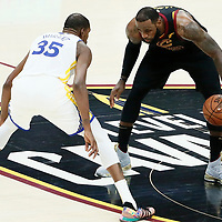 CLEVELAND, OH - JUN 3: Kevin Durant #35 of the Golden State Warriors defends on LeBron James #23 of the Cleveland Cavaliers in Game Three of the 2018 NBA Finals won 110-102 by the Golden State Warriors over the Cleveland Cavaliers at the Quicken Loans Arena on June 6, 2018 in Cleveland, Ohio. NOTE TO USER: User expressly acknowledges and agrees that, by downloading and or using this photograph, User is consenting to the terms and conditions of the Getty Images License Agreement. Mandatory Copyright Notice: Copyright 2018 NBAE (Photo by Chris Elise/NBAE via Getty Images)