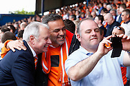 Nick Owen, Director of Luton Town Football Club (left) pauses for photos with fans before the Skrill Conference Premier match at Kenilworth Road, Luton<br /> Picture by David Horn/Focus Images Ltd +44 7545 970036<br /> 21/04/2014