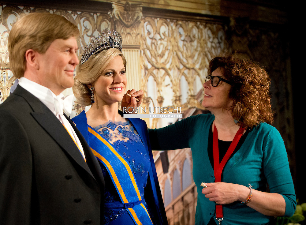 29-4-2014 - AMSTERDAM - King Willem-Alexander and Maxima Queen at Madame Tussauds. Fashion designer Jan Taminiau has a replica of the famous blue dress that made ​​the Queen wore during the change of rule in 2013. Exactly one year after the Throne Changing exhibits wax museums images of the royal couple. COPYRIGHT ROBIN UTRECHT