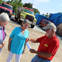 Hamilton Volunteer Fire Chief Raymond Oliver opens an envelope with a $10,000 check from the CREATE Foundation as South Monroe County Community Fund members Kathy Seymour, left, and Susan Honeycutt watch his reaction. The grant will be added to the building fund for a new station to replace the one deemed a total loss due to the April 13 tornado.