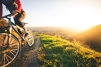 A woman in mid 20s with mountain bike at sunrise in southern Orange County, California. Photo by Robert Zaleski/rzcreative.com