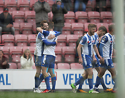 Nick Powell of Wigan Athletic (L) celebrates after scoring his sides third goal - Mandatory by-line: Jack Phillips/JMP - 30/03/2018 - FOOTBALL - DW Stadium - Wigan, England - Wigan Athletic v Oldham Athletic - Football League One