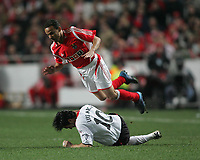 Photo: Lee Earle.<br /> Benfica v Liverpool. UEFA Champions League. 2nd Round, 1st Leg. 21/02/2006. Liverpool's Luis Garcia sends Leo flying.
