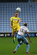 AFC Wimbledon defender & captain Barry Fuller (2) heads the ball during the EFL Sky Bet League 1 match between Coventry City and AFC Wimbledon at the Ricoh Arena, Coventry, England on 28 September 2016. Photo by Stuart Butcher.