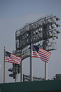 LOS ANGELES - MAY 03:  U.S. flags fly over the stadium with the stadium lights as a backdrop at the Los Angeles Dodgers game against the San Diego Padres at Dodger Stadium on Sunday, May 3, 2009 in Los Angeles, California.  The Dodgers won their 10th straight home game while defeating the Padres 7-3.  (Photo by Paul Spinelli/MLB Photos)