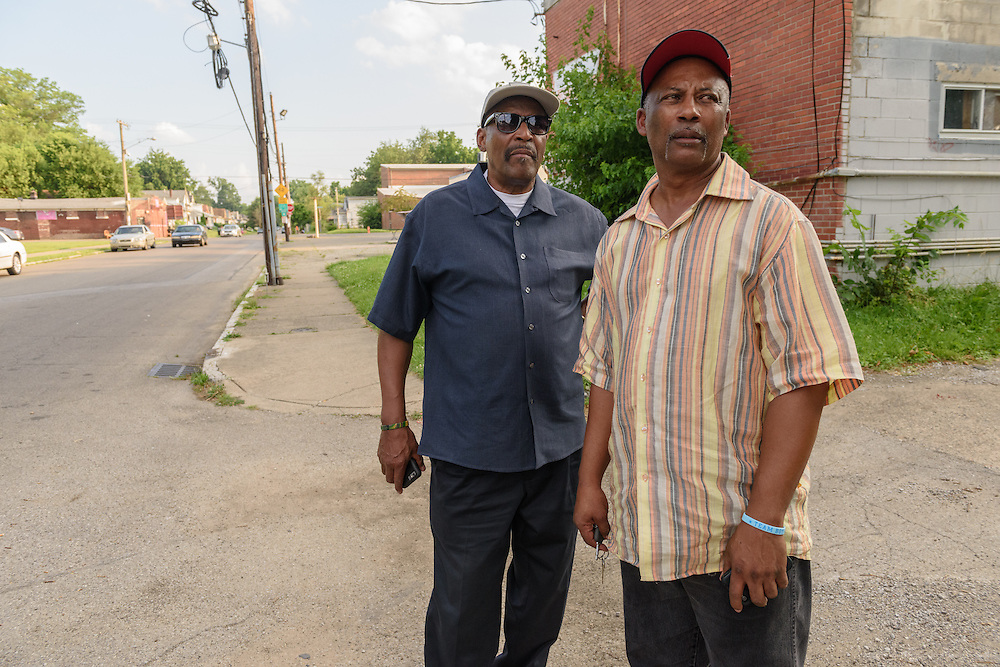 Eddie Woods, director of Street Peace: No More Red Dots, left, and Norman Martin, his childhood friend and Street Peace's team coordinator, look up 32nd Street Monday, June 20, 2016 towards Whitey's Grocery in the Parkland neighborhood. (Photo by Brian Bohannon)