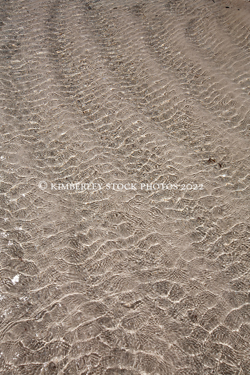 Water ripples in the sand