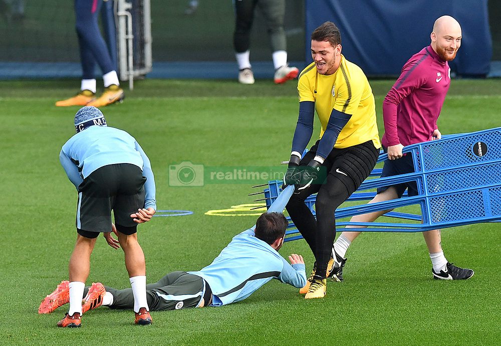 Manchester City goalkeeper Ederson (right) jokes around with team-mate Bernardo Silva during the training session at the CFA, Manchester.