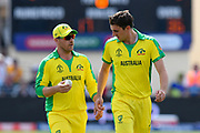Aaron Finch of Australia talks to Pat Cummins of Australia during the ICC Cricket World Cup 2019 match between Afghanistan and Australia at the Bristol County Ground, Bristol, United Kingdom on 1 June 2019.