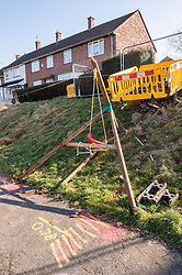 © Licensed to London News Pictures. 24/02/2019. Bristol, UK. A broken swing can be seen on the embankment below where a house exploded in Whitchurch Lane, Hartcliffe. Three people received minor injuries and were taken to hospital and much of the house was destroyed. A large trampoline was used to help some people escape. It is reported that it may have been a gas boiler explosion. Photo credit: Simon Chapman/LNP
