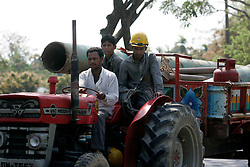 BANGLADESH SRIMANGOL 23FEB05 - A 16-inch gas pipeline gets tranported by tractor and trailer near Srimangol in northern Bangladesh...jre/Photo by Jiri Rezac ..© Jiri Rezac 2005..Contact: +44 (0) 7050 110 417.Mobile:  +44 (0) 7801 337 683.Office:  +44 (0) 20 8968 9635..Email:   jiri@jirirezac.com.Web:    www.jirirezac.com..© All images Jiri Rezac 2005- All rights reserved.